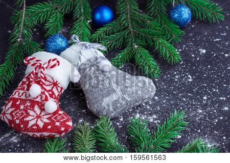 Two Christmas Stockings On Snowbound Black Background With Blue Balls