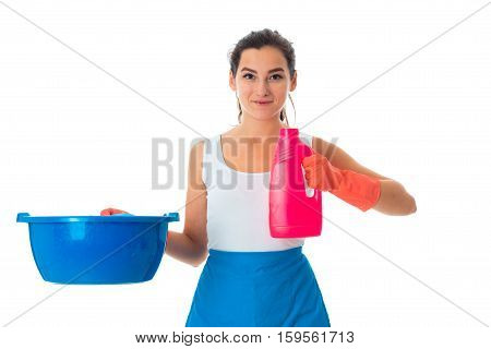 cheerful young maid woman in uniform with cleansers isolated on white background
