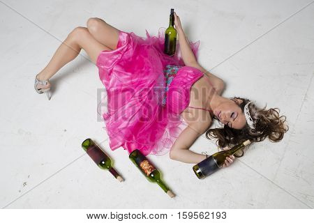 A brunette female is passed out after a night of drinking