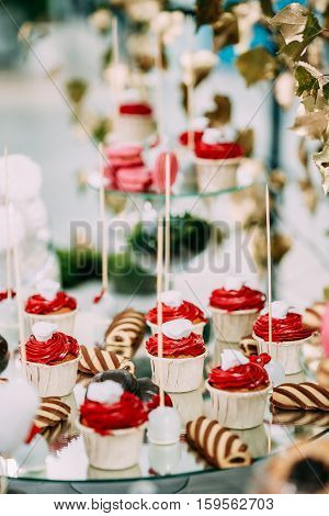 Dessert Sweet Tasty Cupcakes And Cookies In Candy Bar On Table. Delicious Sweet Buffet. Wedding Decorations