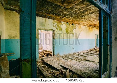 The Ruined Floor, Seiling Of Abandoned School After Chernobyl Disaster In Evacuation Zone. The Terrible Consequences Of The Nuclear Pollution Twenty Years Later.