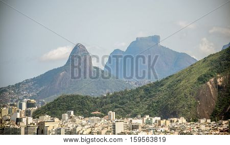 View of Copacabana district on the background of Vidigal distict, Dois Irmaos Mountain and Pedra da Gavea, Rio de Janeiro, Brazil