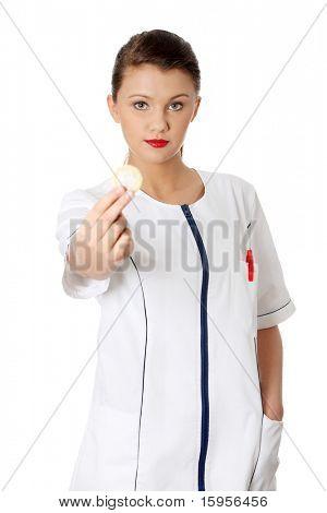 Female doctor holding condom