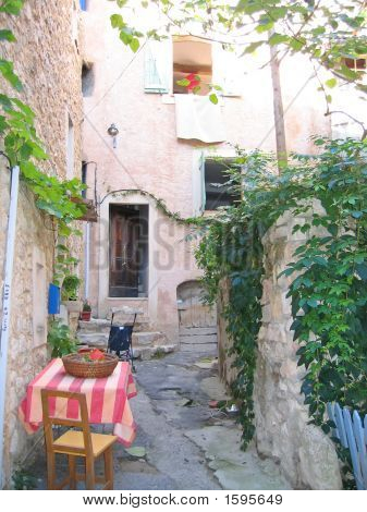 Small Provencal City Path With Chairs And A Coloured Table, Azur Coast, South Of France