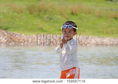 Japanese boy with water gun (3 years old)