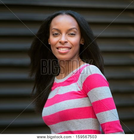 Close-up portrait of beautiful african american smiling young adult woman