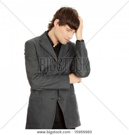 Young businessman with a big headache or problem, isolated on white