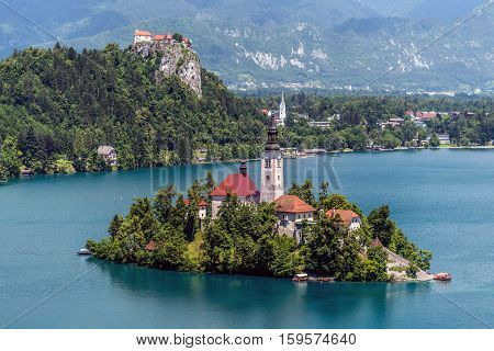 Aerial view of Lake Bled, a lake in the Julian Alps of the upper Carniola region, Slovenia, with the pilgrimage church of the Assumption of Maria, on the Bled island, taken from Osojnica hill