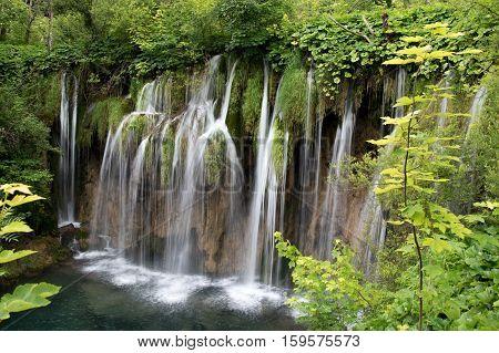 Beautiful waterfall in the upper lakes area (Gornja jezera), Plitvice lakes national park (Plitvicka Jezera), Lika-Senj county, Croatia.