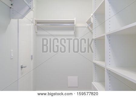 Empty closet, working closet, cupboard in bedroom.
