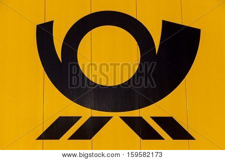 HANNOVER / GERMANY - NOVEMBER 27 2016: german mail service ( Deutsche Post ) logo on a yellow container