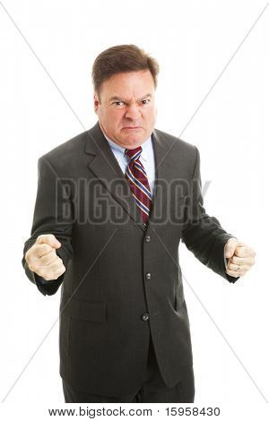 Businessman is red faced and very angry.  Isolated on white.