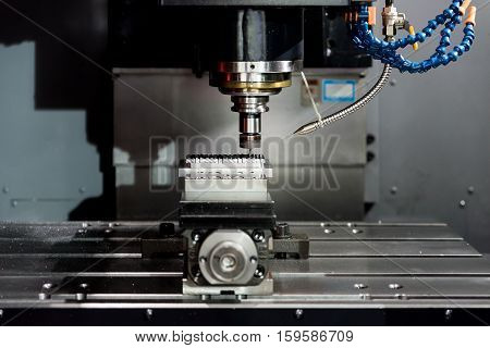Industry machining precision part by CNC machine center working in factory