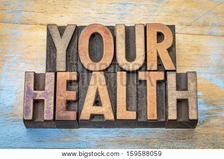 your health - word abstract in vintage letterpress wood type