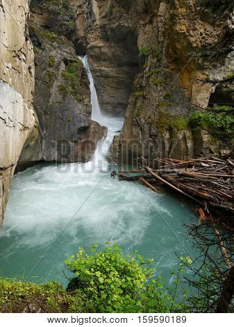 Waterfall into a wild gorge, Canadian Rockies