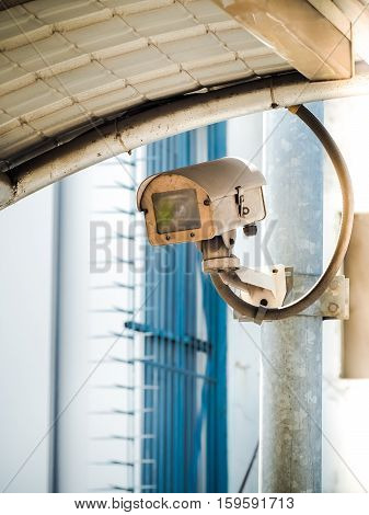 CCTV camera security in a city, Retro color with place your text (security, safety, technology)
