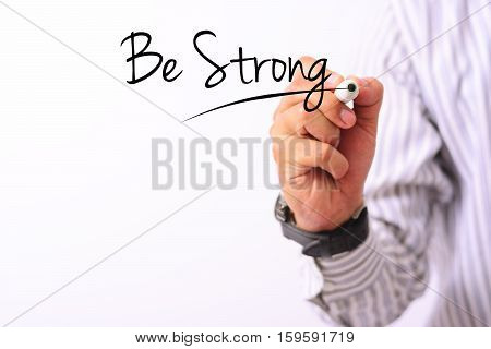 business concept image of a hand holding marker and write be strong isolated on white