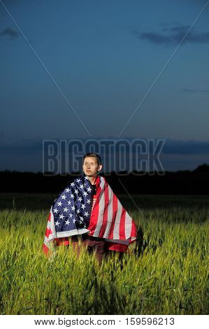 Man In A Wheat Field With American Flag