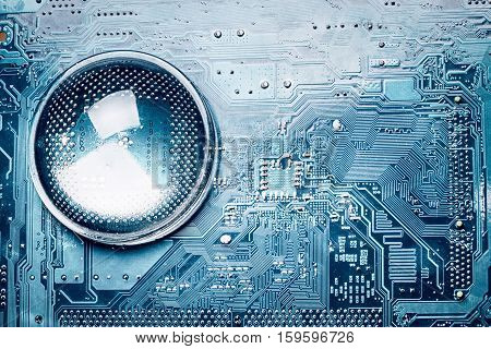 blue printed circuit board and magnifying glass