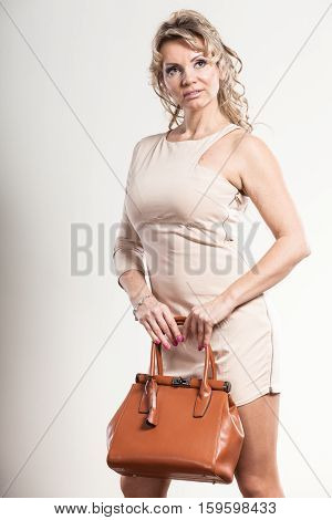 Mature Elegant Woman Holds Handbag