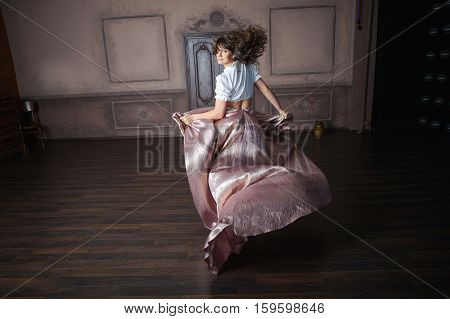 Cheerful Girl In A Long Dress