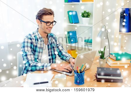 Smiling smart businessman in glasses working in office on xmas holidays