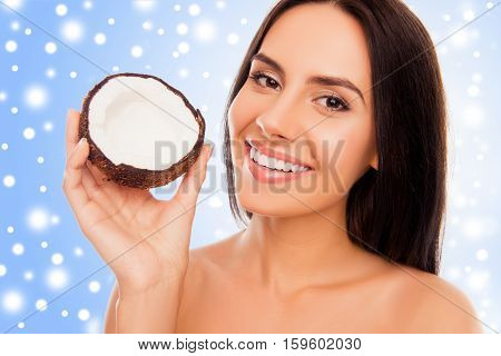 Portrait Of Young Woman  Holding Half Of Coconut, Xmas Concept