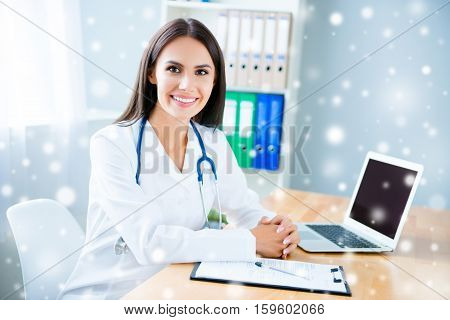 Happy Female Doctor On Consultation On Snowy Background