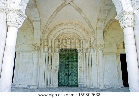 Casauria,  Italy - August 20, 2006:  The entrance portal of the St. Clemente basilica