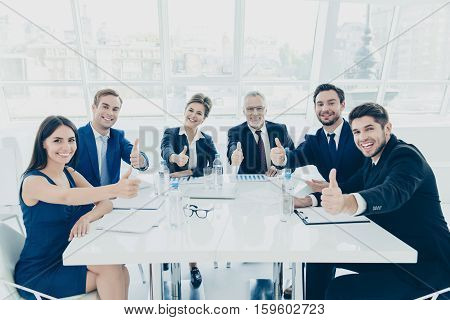 Briefing. Group Of Famous Successful Business People Showing Thumbs Up