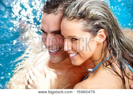 Young loving couple relaxing in the water. Vacation.