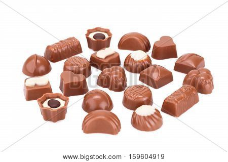 Assortment of chocolate isolated on white background.