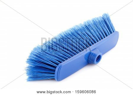 Blue broom isolated on white background, close up picture.