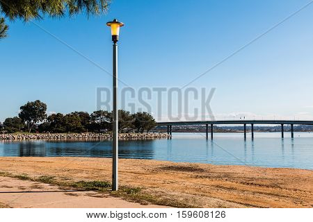 Vacation Isle Park Lamppost with Mission Bay and Ingraham Street bridge in the background.