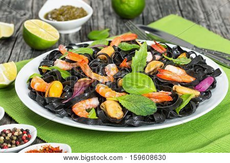 Delicious Black Noodles Salad With Prawns, Mussels, Fresh Green Leaves