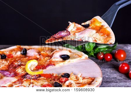 Delicious fresh Pizza with red fish and mozzarella on the wooden background. Top view.