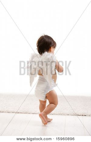 One year old baby girl wearing white angel wings and diaper. Back view, isolated on white background.?