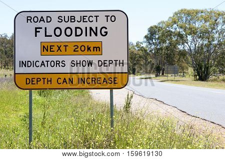 Road flooding sign in an outback country road, NSW, Australia