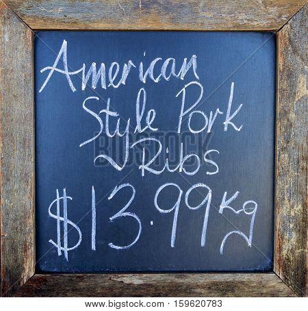 Pork ribs sign outside a butcher's shop, Australia