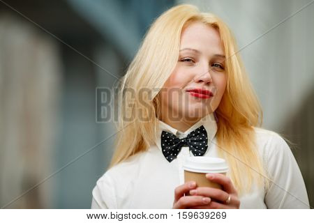 Businesswoman ginger in black bow tie in office