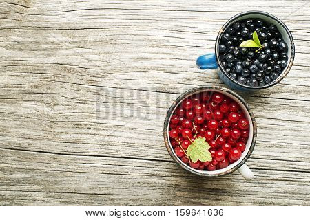 Blueberries and red currant on wooden background