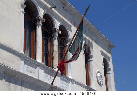 Furled Flag On A Building In Venice