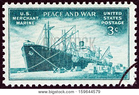 USA - CIRCA 1946: A stamp printed in USA shows Liberty type freighter unloading cargo, circa 1946.