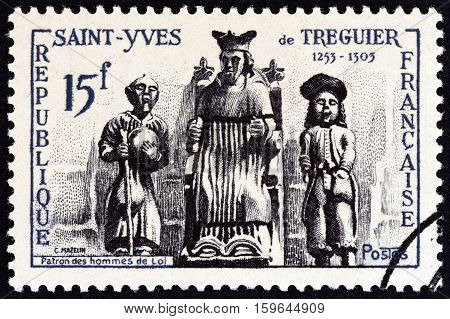 FRANCE - CIRCA 1956: A stamp printed in France issued for the St. Yves de Treguier Commemoration shows St. Yves de Treguier patron saint of lawyers., circa 1956.