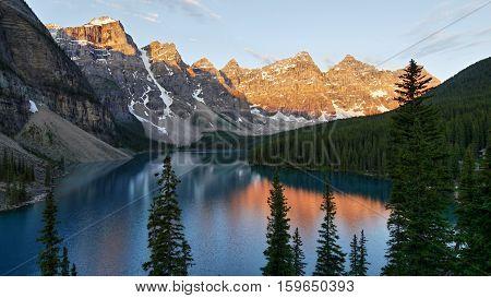 Moraine lake at sunrise. Red morning light. Alberta, Canada