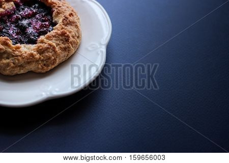 Mini blueberry galettes. Free space for your text