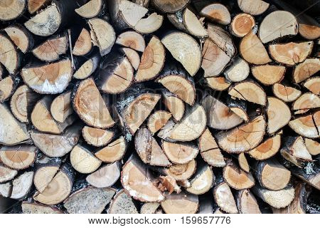a pile of chopped brown fire wood