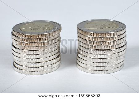 Euro coins stacks closeup  on white table.