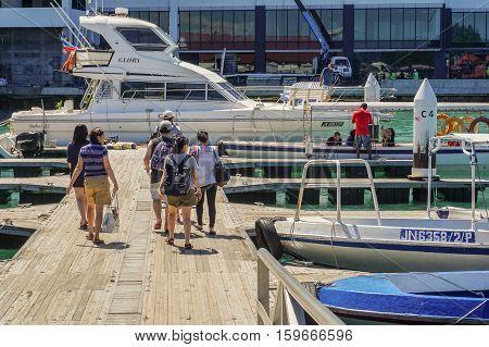 Kota Kinabalu,Sabah-Nov 28,2016::Tourists on the speedboat at Jetty Jesselton Point,Kota Kinabalu,Sabah.The jetty provided tourists facilities to the famous islands in Tunku Abdul Rahman Marine Park.