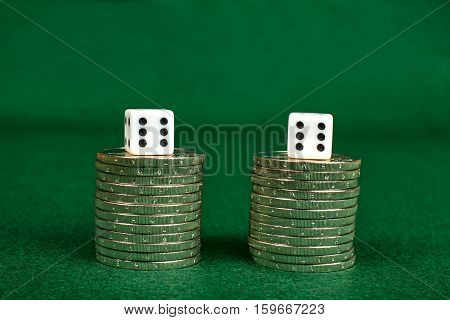 Coin stacks and two dices over the top of them.
